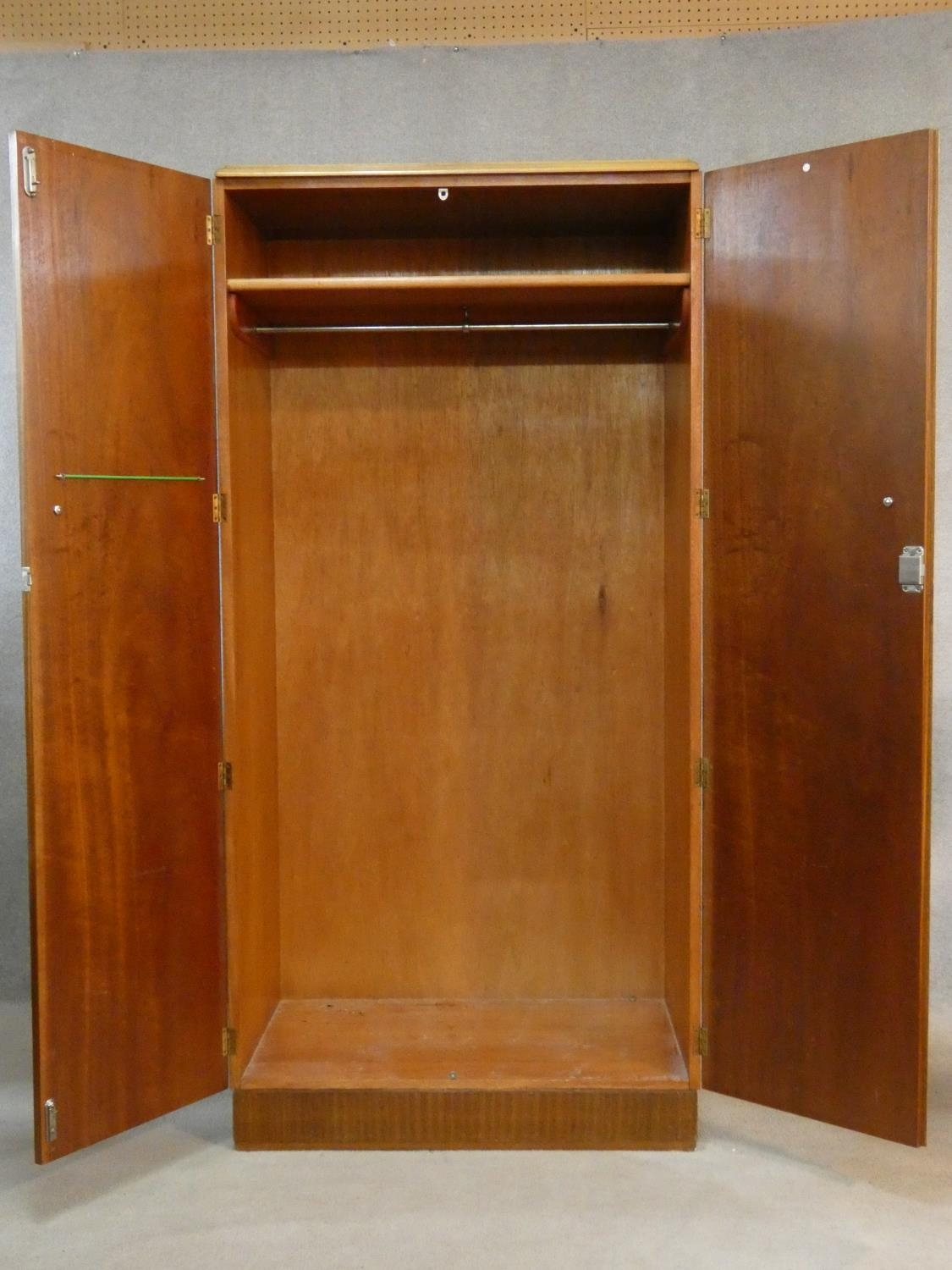 A 1960's teak wardrobe fitted with shelf and hanging space with inset Heal's disc to the inside of - Image 3 of 6