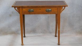 A 19th century oak Art Nouveau style writing table with frieze drawer on square tapering supports.