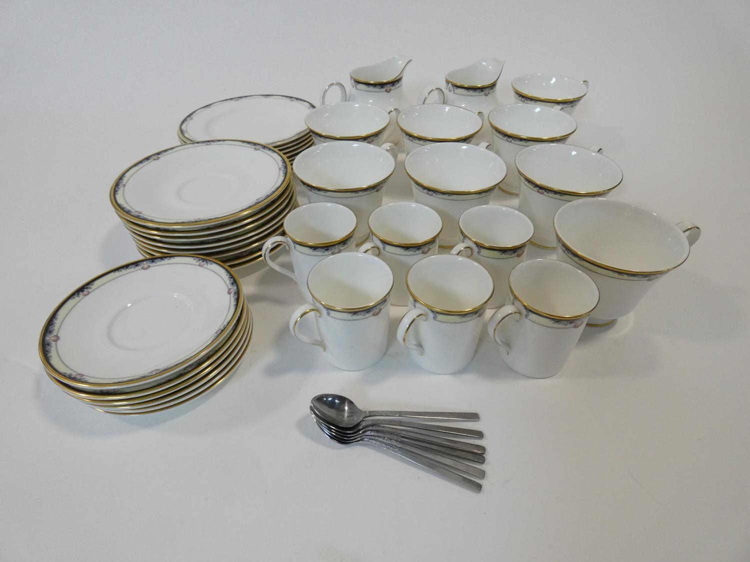 A Royal Doulton Rhodes design tea and coffee set to include cups, saucers and milk jugs. H.17cm