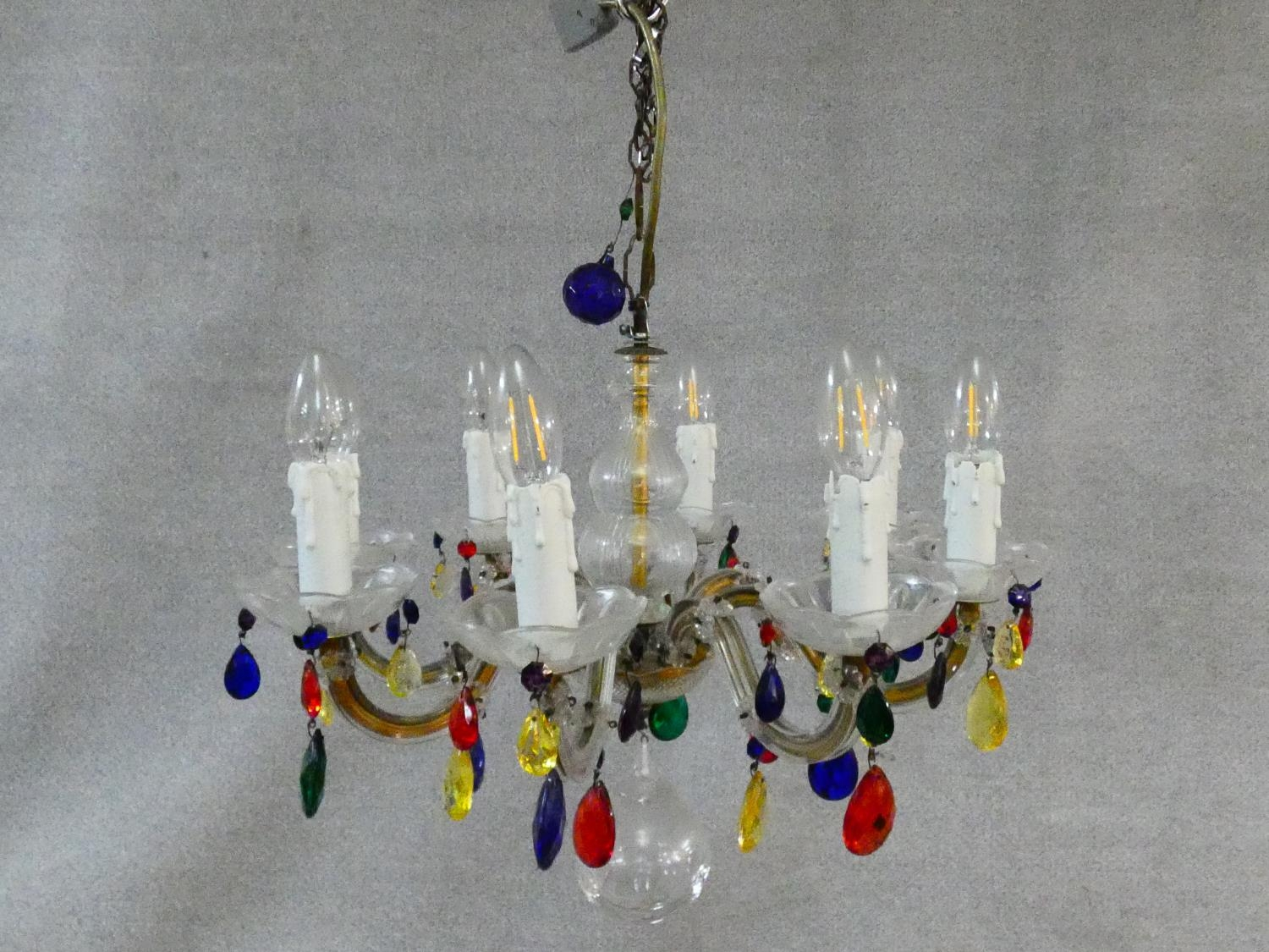An eight branch glass framed ceiling chandelier with polychrome crystal drops. H.57 D.52cm - Image 2 of 7