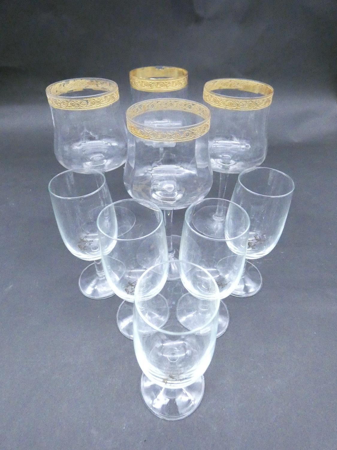 A collection of glasses. Including a set of five sherry glasses with gilded Orion symbols, along
