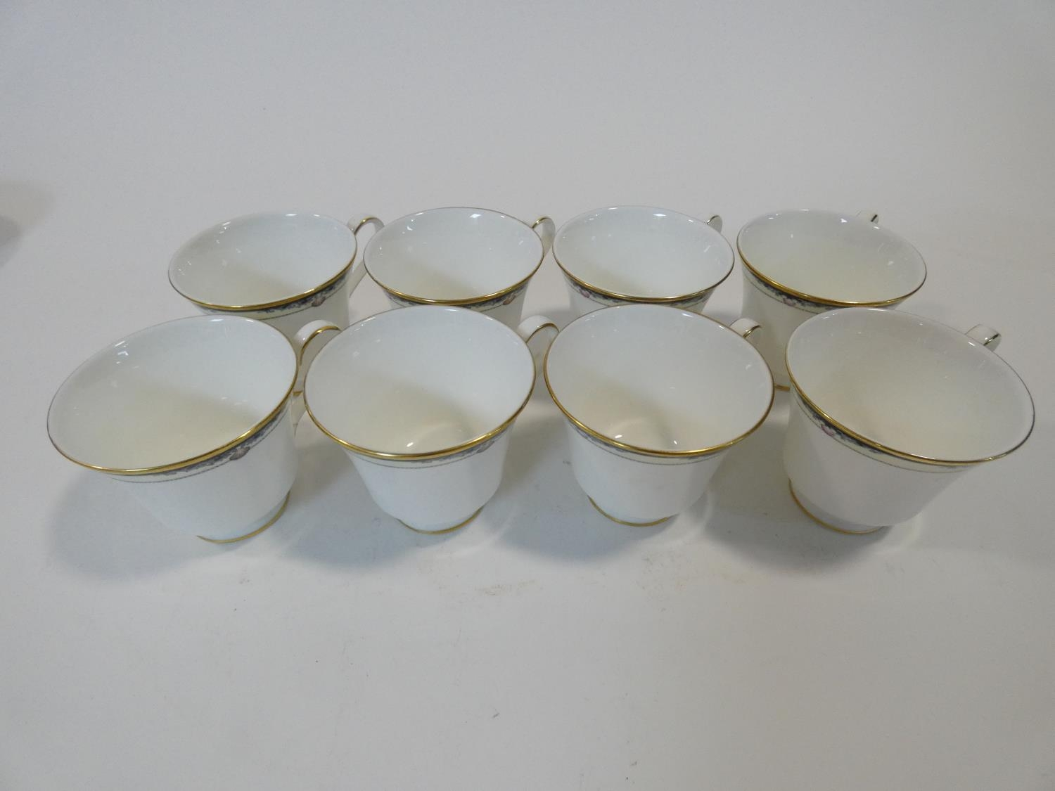 A Royal Doulton Rhodes design tea and coffee set to include cups, saucers and milk jugs. H.17cm - Image 17 of 34
