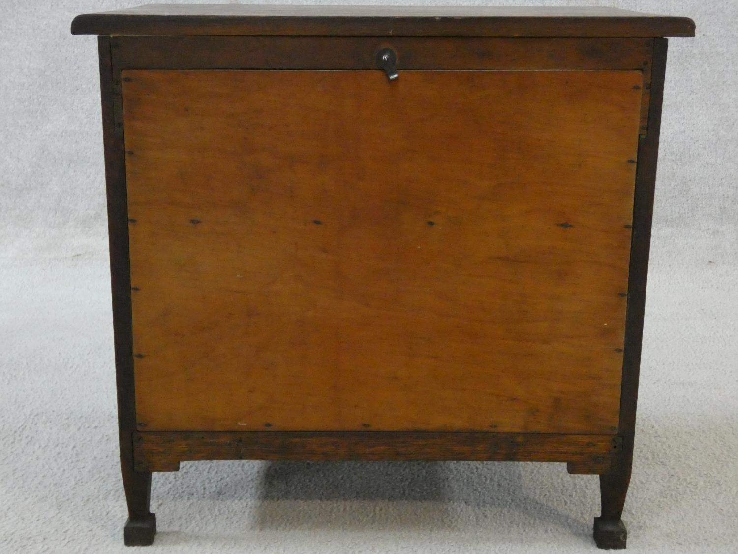 An early 20th century country oak style side cabinet with carved panel doors on squat square - Image 11 of 14