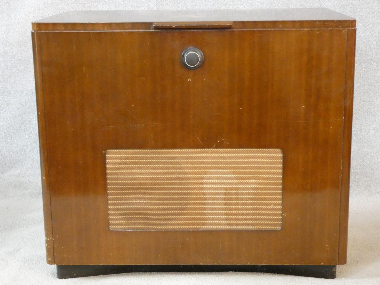 A vintage teak floor standing Ekco radiogram and record player. H.72 W.83 D.39cm
