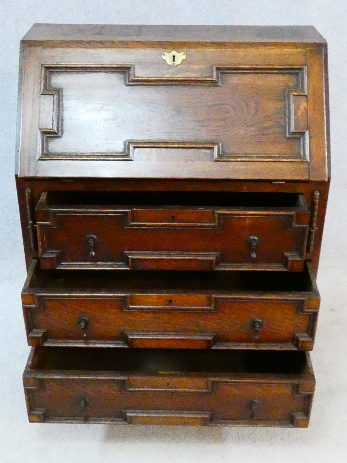 A mid century Jacobean style oak bureau with lozenge inset panels and fall front revealing fitted - Image 5 of 26