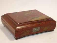 An antique Japanese lacquered fitted gaming box with hand painted gilt decoration depicting a