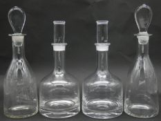 A pair of contemporary Dartington Frank Thrower mallet form decanters and cylindrical stoppers and a