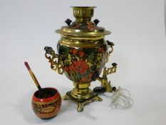 A vintage electric hand painted brass Russian samovar. With fruit and floral design and scrolling