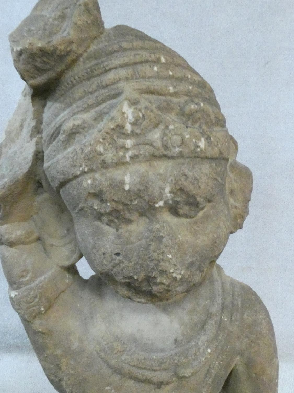 A 14th/15th century South East Asian carved sandstone figure of a deity mounted on a square - Image 2 of 5