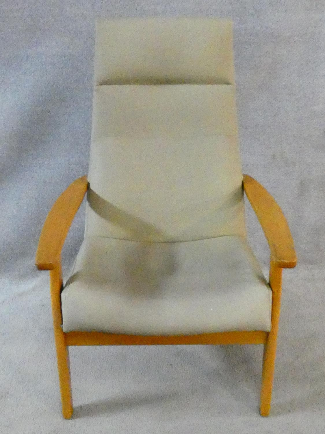 A vintage Parker Knoll, model PK 1067-70 from 1968, beech framed lounge chair. H.102cm