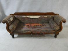 A Victorian mahogany framed double scroll end sofa with long squab cushion and end bolsters on