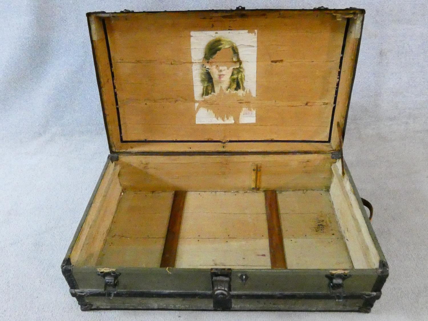 A vintage metal bound lidded travelling trunk with twin iron carrying handles. H.32xW.92xD.53cm - Image 7 of 8