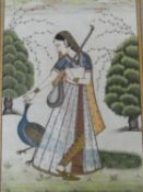 A 20th century framed and glazed Indo-Persian silk painting of Princess Maru with a peacock. With