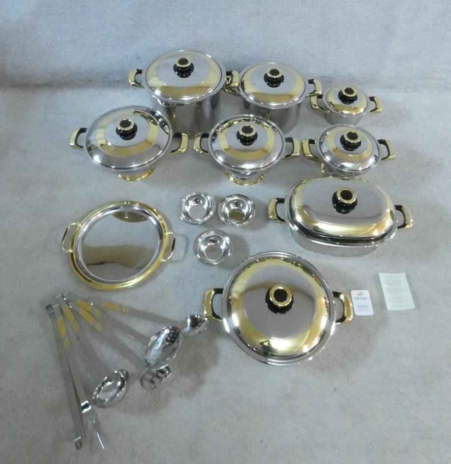 A set of boxed stainless steel as new Cameo Royale pans and cookware with 24k gold plated