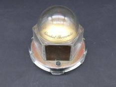 A vintage American Mova desktop barometer in perspex domed case. Makers stamp to the base. H.10cm