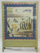 A vintage painted frame fire screen with glazed embroidered tapestry panel depicting the wildlife