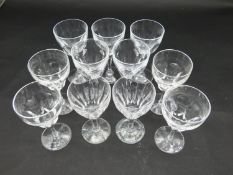 Eleven cut crystal sherry glasses with faceted petal design. H.15cm