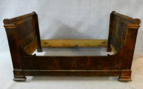 A 19th century French mahogany bateau lit, to take a single mattress. H.112 L.202 W.123cm