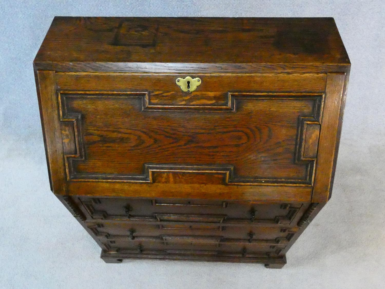 A mid century Jacobean style oak bureau with lozenge inset panels and fall front revealing fitted - Image 17 of 26