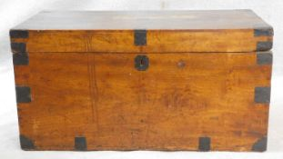 A 19th century metal bound camphor travelling trunk fitted with candle box and twin iron carrying
