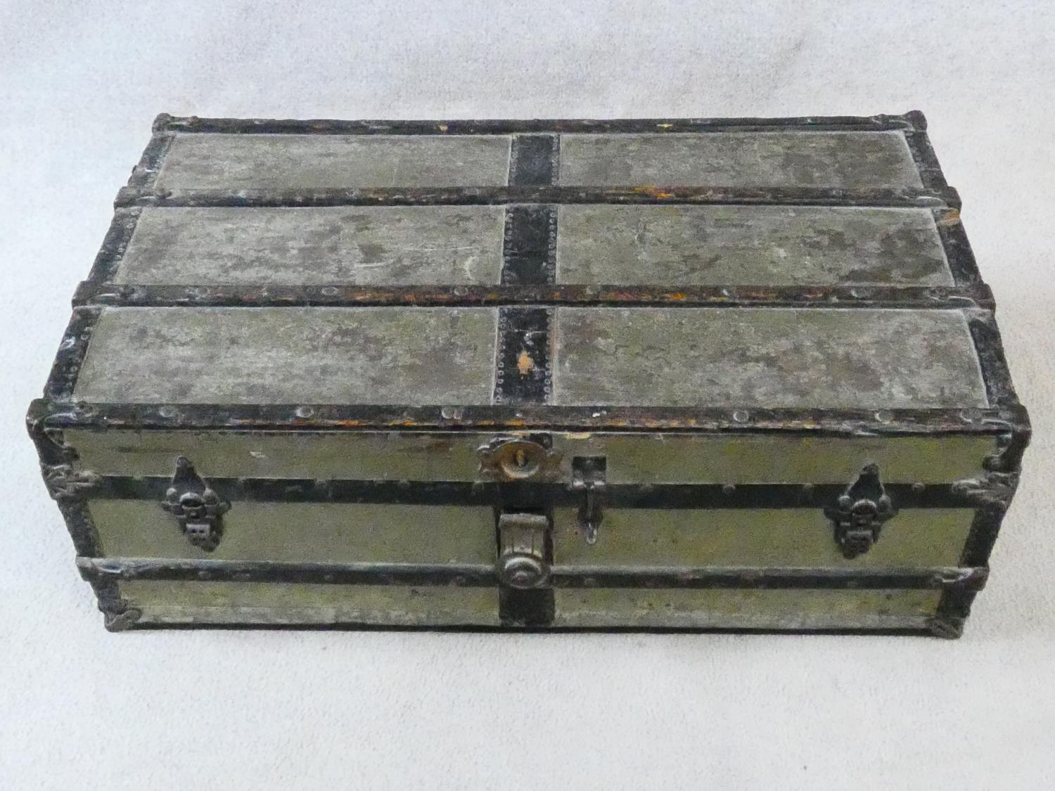 A vintage metal bound lidded travelling trunk with twin iron carrying handles. H.32xW.92xD.53cm - Image 2 of 8