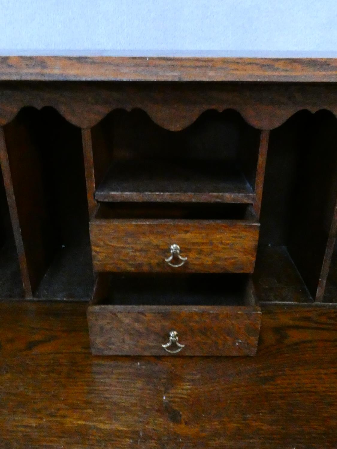 A mid century Jacobean style oak bureau with lozenge inset panels and fall front revealing fitted - Image 21 of 26