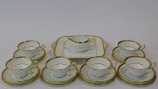 A six person part scrolling gilded design porcelain Wedgwood coffee set, pattern number W4249.
