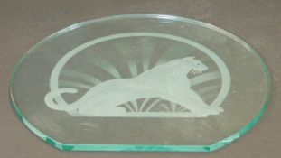 An Art Deco style glass sculptured and engraved glass panel of a seated panther, signed Mark