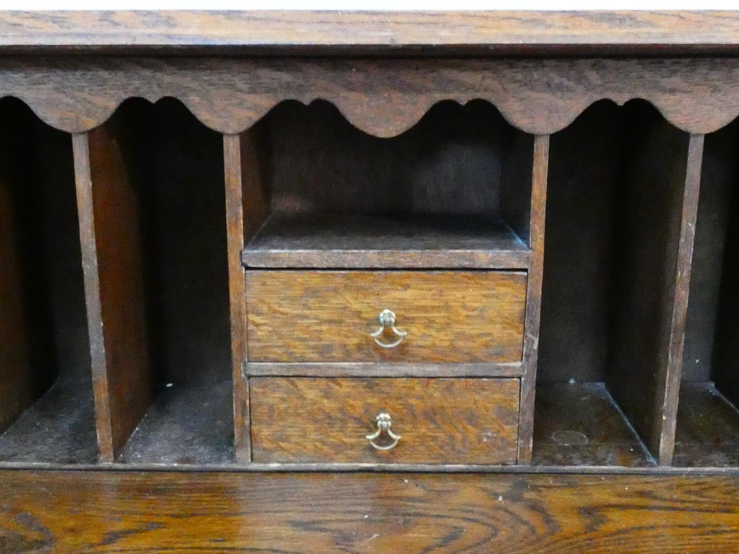 A mid century Jacobean style oak bureau with lozenge inset panels and fall front revealing fitted - Image 19 of 26