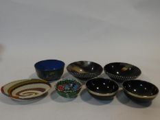 A collection of bowls. Including a Chinese cloisonne enamel bowl, four carved horn and white metal