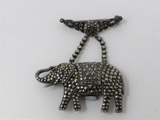 An Art Deco silver, marcasite and ruby novelty elephant brooch watch. Set with round mixed cut