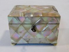 A small antique mother of pearl tea caddy, of rectangular form, the hinged lid revealing a mother of