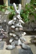 Ross Bonfanti, concrete and mixed material sculpture, a pyramid of bunny rabbits, comes in four