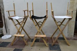 Three director's style high chairs with branded canvas backs and seats. H.125xW.55cm