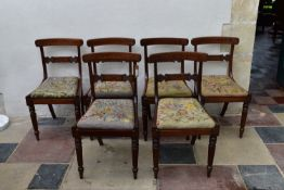A set of six Regency beech framed faux rosewood painted dining chairs with profusely inlaid bar