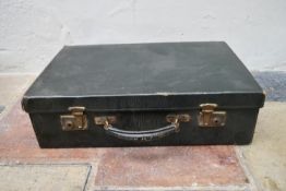 An early 20th century leather travelling gentleman's dressing case, well fitted with a wide