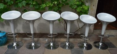 A set of six moulded seat and chrome based bar stools with adjustable rise and fall action. H.