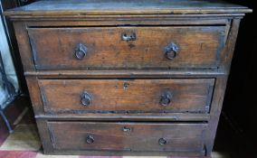 An early 18th century country oak chest of three long drawers. H.79xW.110xD.60cm (missing it's