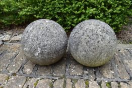 A pair of large weathered stone garden spheres. H.30cm