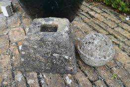 A small carved stone garden pyramid and spherical finial. H. 50cm