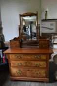 A late 19th century straight grain and burr walnut dressing table with swing bevelled plate above an