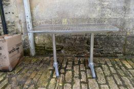 A chrome framed cafe table. H.80xW.105cm