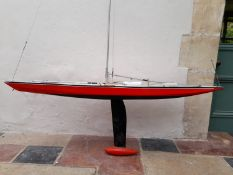 A large scratch built model of a racing yacht fitted with removable hull, comes with a spare short