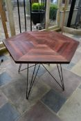 A stained pine conservatory table on metal hairpin base. H.76xW.106cm