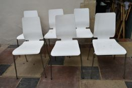 A set of six painted laminated dining chairs on tubular chrome bases. H.90xW.42cm