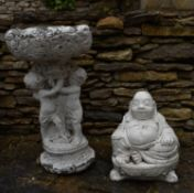 A painted cast concrete bird bath and a figure of a seated Buddha. H.40cm