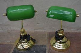 A pair of brass banker's desk lamps with adjustable green glass shades. H.40cm (2)