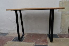 A teak planked top conservatory console table on metal trestle style base. L.80xW.120.D36cm