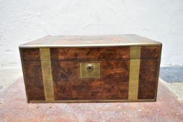 A well fitted early 19th century brass and burr walnut writing slope with inset tooled leather
