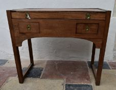 An early 19th century mahogany campaign washstand with hinged lidded top revealing fitted interior
